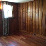 Wood paneled den before staging